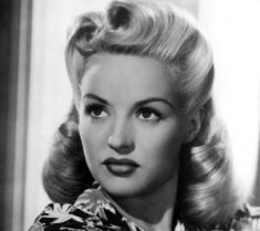 The History of the 1940s Victory Rolls Hairstyle