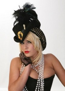 a model for Blonde Swan hat boutique wearing one of their deluxe Elizabethan riding hats.