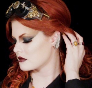 Ashley of Hollywood Noir Makeup wearing a steampunk inspired gold and brown smokey eye
